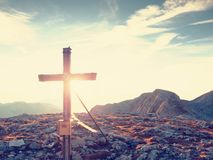 Traditional cross at mountain top in Alp. Cross monument to the dead climbers Royalty Free Stock Images