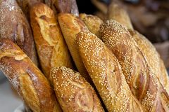 Traditional crusty French bread baguette in basket at bakery. Fresh organic pastry at local market. France cuisine background stock photo