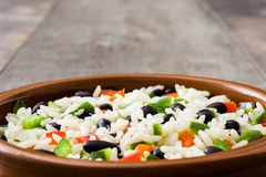 Traditional cuban rice, black beans and pepper on wood. Moros y cristianos. Traditional cuban rice, black beans and pepper on wooden table background. Moros y Royalty Free Stock Photos