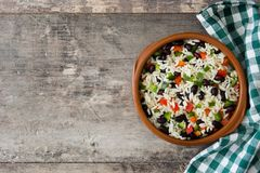 Traditional cuban rice, black beans and pepper on wooden table background. Moros y cristianos. Top view copyspace Stock Photography