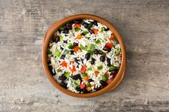 Traditional cuban rice, black beans and pepper on wooden table background. Moros y cristianos. Top view Stock Image