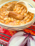 traditional cuisine beans with sausage and red onion Stock Photo