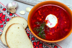 Traditional cuisine: red borscht. Traditional cuisine: red Ukrainian borscht with sour cream Stock Image