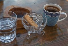 Traditional cup of greek coffee cookie water ashtray royalty free stock images