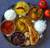 Traditional andhra vegetarian thaali meals. Traditional curries and rice in Andhra vegetarian thaali meals served in a steel plate.Traditional recipes consisting royalty free stock photo