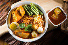 Traditional curry spicy noodle soup Stock Images