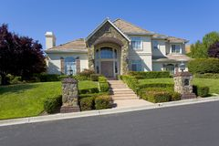 Traditional Custom Home- Two-story With Stonework. External shot of a traditionally designed, custom two story home featuring great stonework Stock Photo