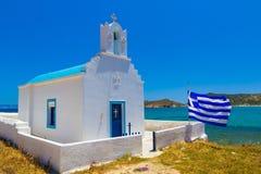 Traditional cycladic church near the beach, Paros Island, Cyclades, Aegean, Greece. Traditional cycladic church near the beach with greek flag, Paros Island Stock Photos