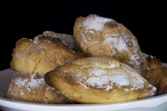 Traditional Cypriot pastry Ä°ci Dolu with walnut inside and powder sugar on top royalty free stock photography