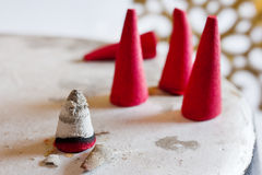 Traditional Czech christmas - red smoking incense cones on metal plate Stock Photos