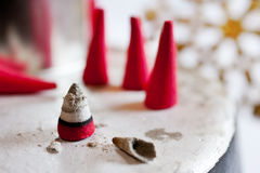Traditional Czech christmas - red smoking incense cones on metal plate Stock Image