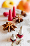 Traditional Czech christmas - smoking incense cones with star anise spice and apples Stock Images