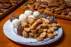 Traditional Czech Christmas sweets, tea cookie, sweet balls and gingerbread. On plate on wooden table royalty free stock images