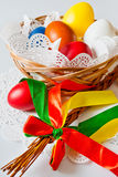 Traditional Czech easter decoration. Regional whip with ribbons  and decorated  eggs in the wicker scuttle. Spring easter holiday arrangement Stock Photo