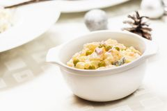 Traditional potato salad. Traditional czech potato salad with mayonnaise and vegetables in white plate royalty free stock photo