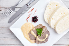 Traditional Czech and Slovak sirloin with cream sauce and dumplings Royalty Free Stock Photography