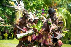 Drummer and dancer together at impressive dance ceremony, New Guinea