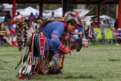 A traditional dance at the 49th annual United Tribes Pow Wow. BISMARK, NORTH DAKOTA, September 9, 2018 : A dancer of the 49th annual United Tribes Pow Wow, one stock photos