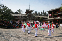 Traditional dancers from a minority group perform in Lijiang Old Town Stock Image