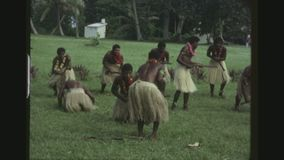 Traditional Dances Of The Kava Ceremony. FRENCH-POLYNESIA, TONGA, JANUARY 1976. Two Shot Sequence Of Tonga Male Warrios Performing Dances During The Royal Kava stock video footage