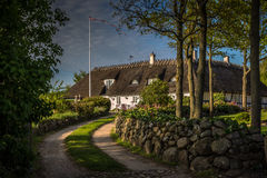 Traditional danish house under a straw roof Stock Photography