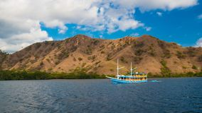 Traditional day boat in Komodo National Park. One of the many day boats that divers can use to access Komodo National Park from Flores. In front of Rinca island royalty free stock photos