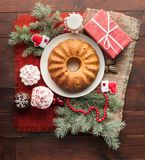 Traditional decorated christmas cake at wooden table Stock Image
