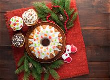 Traditional decorated christmas cake at wooden table royalty free stock image