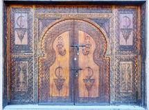 Traditional decorated door in Agadir, Morocco. Traditional old decorated door in Agadir city, Morocco Royalty Free Stock Photography