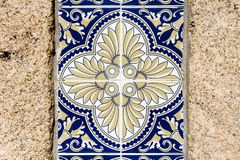 Traditional decoration of the facade of the house in Porto. Typical Portuguese and Spanish ceramic tiles azulejos stock image