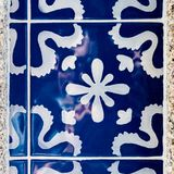 Traditional decoration of the facade of the house in Porto. Typical Portuguese and Spanish ceramic tiles azulejos stock photography