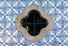 Traditional decoration of the facade of the house in Porto. Typical portuguese and spanish ceramic tiles Azulejos. Around rosette stone window stock photo