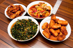 Traditional Delicious Home Cooked Food. A traditional Asian home cooked food comprising of stir fried morning glory, fried chicken, mixed curry and deep fried stock photography