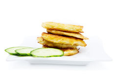 Traditional delicious potato pancakes. Served with sour cream isolated on white background Stock Photography