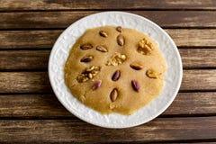 Traditional delicious Turkish dessert; irmik helva, halvah royalty free stock image