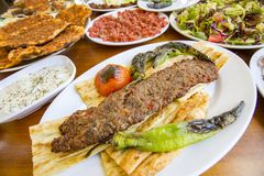 Traditional Delicious Turkish foods; Adana Kebab, Grilled meat royalty free stock photos