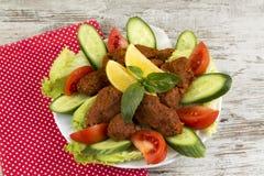 Traditional Turkish foods; bulgur kofte cig kofte. Traditional delicious Turkish foods; bulgur kofte cig kofte stock image