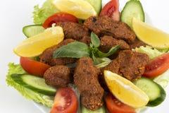 Traditional Turkish foods; bulgur kofte cig kofte. Traditional delicious Turkish foods; bulgur kofte cig kofte stock photo