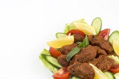 Traditional Turkish foods; bulgur kofte cig kofte. Traditional delicious Turkish foods; bulgur kofte cig kofte stock photos