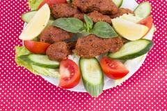 Traditional Turkish foods; bulgur kofte cig kofte. Traditional delicious Turkish foods; bulgur kofte cig kofte royalty free stock photo