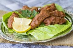 Traditional Delicious Turkish foods; bulgur kofte cig kofte.  royalty free stock image
