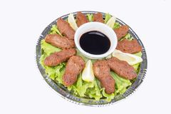 Turkish foods; cig kofte. Traditional delicious Turkish foods; bulgur salad, cig kofte stock images