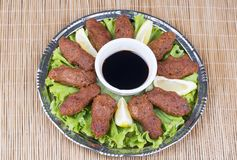 Turkish foods; cig kofte. Traditional delicious Turkish foods; bulgur salad, cig kofte royalty free stock photo