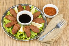 Turkish foods; cig kofte. Traditional delicious Turkish foods; bulgur salad, cig kofte royalty free stock photography