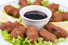Turkish foods; cig kofte. Traditional delicious Turkish foods; bulgur salad, cig kofte royalty free stock images