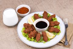 Turkish foods; cig kofte. Traditional delicious Turkish foods; bulgur salad, cig kofte stock photography