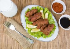 Turkish foods; cig kofte. Traditional delicious Turkish foods; bulgur salad, cig kofte royalty free stock photos