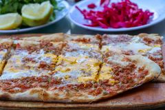 Traditional delicious Turkish foods; meat with eggs pide stock photography