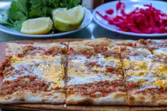 Traditional delicious Turkish foods; meat with eggs pide stock photos