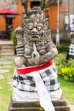 Traditional demon guard statue carved in stone in Bali Stock Images